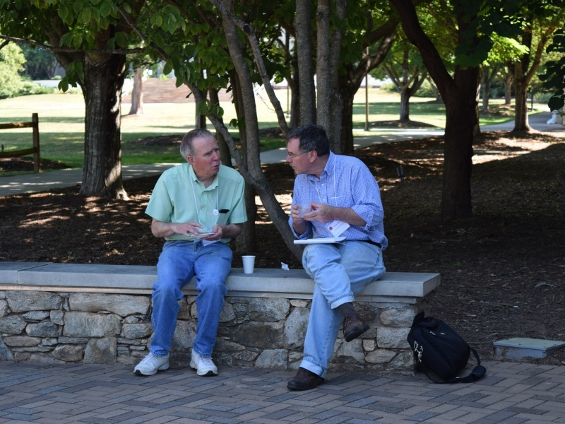William Spellman (left), COPLAC Director, and Simon Gray (right), GLCA Program Officer, meet during morning break Saturday, June 11 outside of Rhoades Robinson Hall.