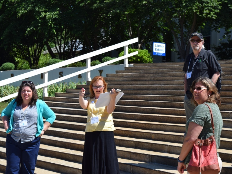 Ellen Pearson (yellow shirt), COPLAC Digital Co-PI, helps group faculty members on Friday, June 10 in front of Ramsey Library.