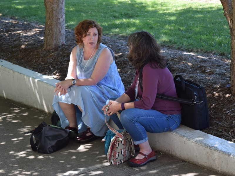Janet Wesselius (left) meets with a potential teaching partner on Friday, June 10 in front of Ramsey Library.