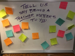 Summer Institute participants display sticky notes with the reasons why being a teacher matters to them.