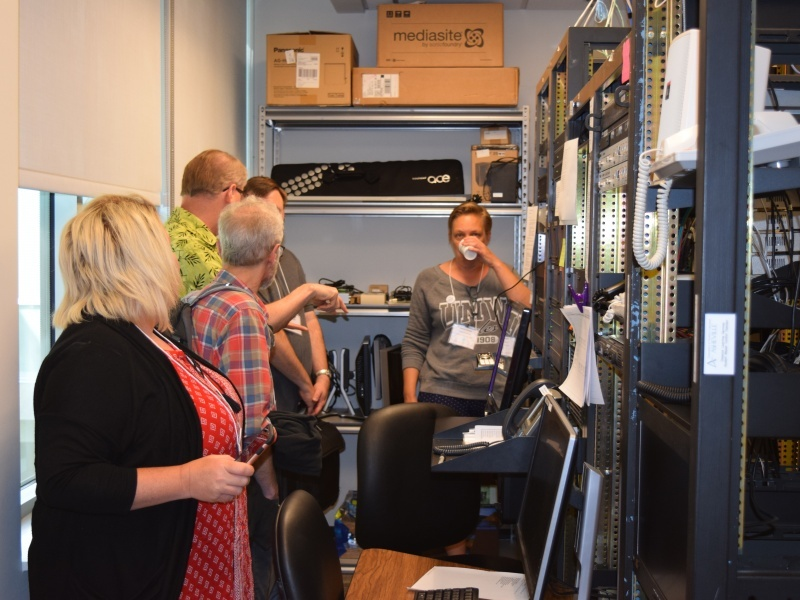 Greg Dillingham (green shirt), UNC Asheville Distance Learning Services Manager, leads tour of UNCA Distance Learning facilities on Saturday, June 11 in Rhoades Robinson Hall.